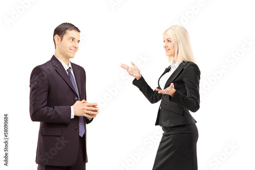 Two businesspeople having conversation together