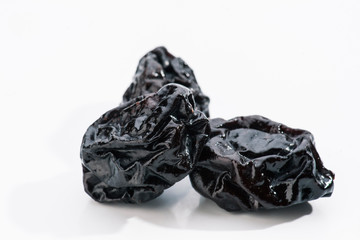 group of prunes on white base