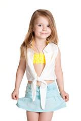 little girl wearing blue skirt