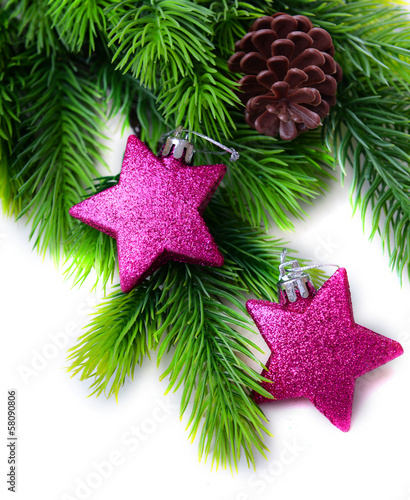 Christmas decorative stars on fir tree, isolated on white