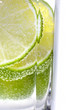 Detail of sliced lime in glass of water