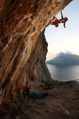 Rock climber at sunset. Kalymnos Island, Greece.