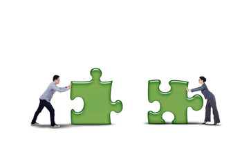 Isolated business partner putting together two puzzle
