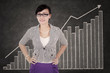Smiling businesswoman with growth graph