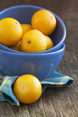 Fresh ripe orange tangerines ib blue bowl.