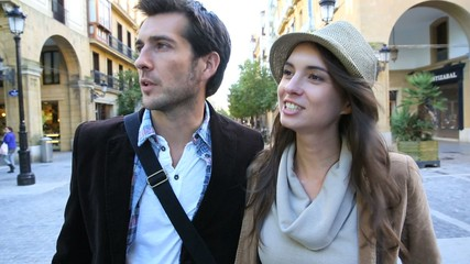 Couple walking in town