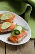 Sandwich with red fish (salmon) and cucumber