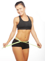 beautiful sporty woman looking at measure