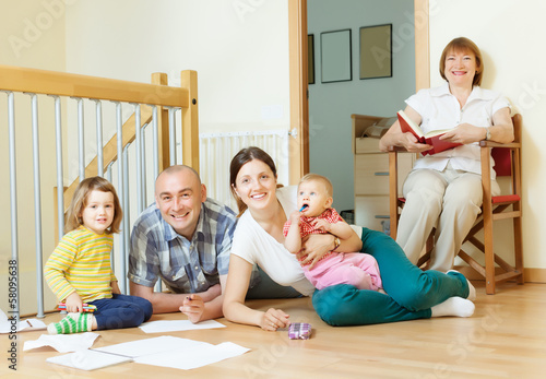 happy multigeneration family  enjoying   in home
