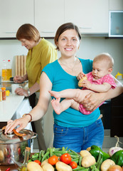women of three generations in domestic kitchen