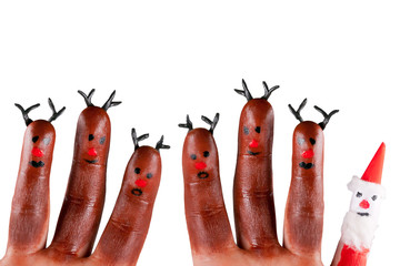 funny reindeer and Santa painted on fingers