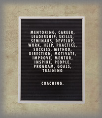 Coaching concept in plastic letters on very old menu board