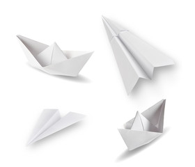 set of paper ships and paper planes on white