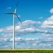 Wind generator turbine on summer landscape