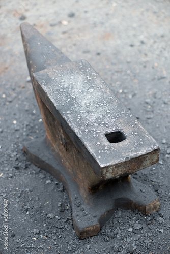 Vertical shot of vintage rustic anvil