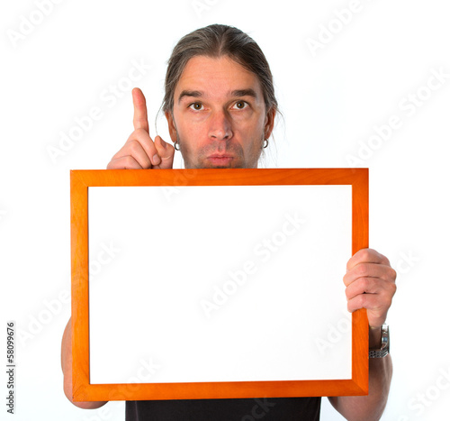 man with white signboard is showing the forefinger