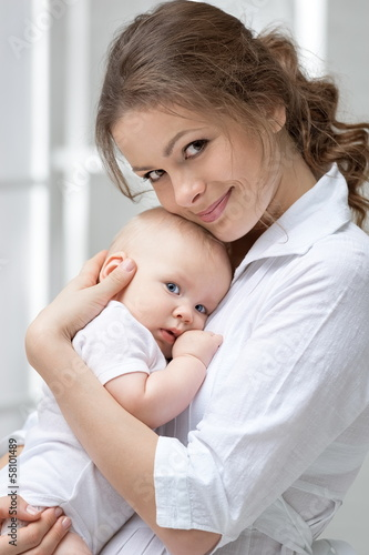 Portrait of happy mother and baby