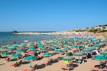 View of beach with umbrellas at beach near Vieste, Apulia,Italy