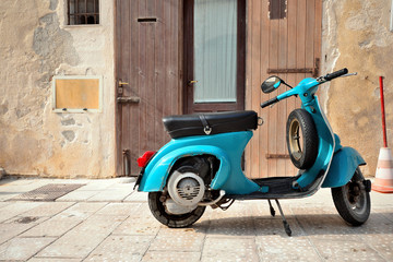 Vintage italian scooter Vespa on old medieval street