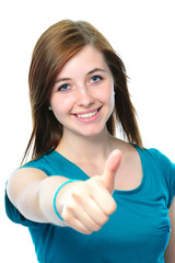 female teenager shows a thumbs up