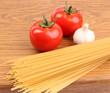 Spaghetti garlic and tomatoes on board.