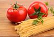 Spaghetti and tomatoes on board.