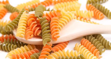 Italian pasta on wooden spoon.