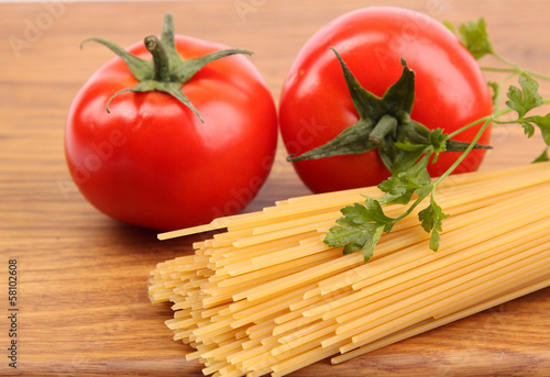Spaghetti and tomatoes on board.