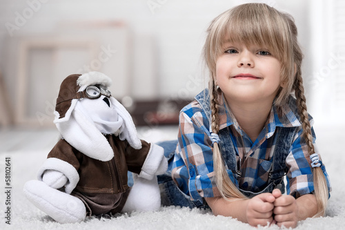 Portrait of a little girl with a toy bunny-pilot