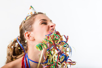 Woman at boring birthday party with streamer