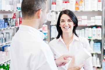 Smiling customer in a pharmacy