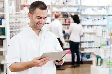 Pharmacist using a tablet to Placing Orders