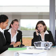 Three successful businesswomen in a meeting