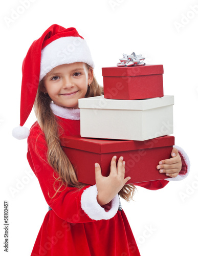 Girl in christmas outfit holding presents