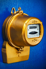object on blue - Golden retro electric meter