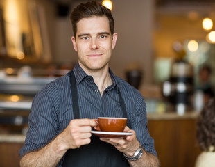 Barista with Coffee Cup