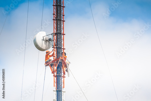 Tower climber and working on cellular tower system.