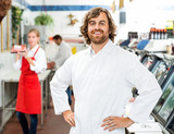 Portrait Of Confident Butcher Standing At Store
