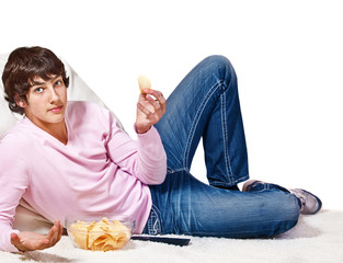 Teenager with crisps  and remote control