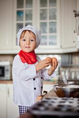 Little boy baking muffins