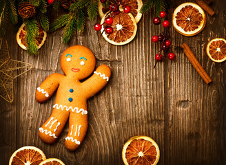 Gingerbread Man over Wood. Christmas Holiday Background