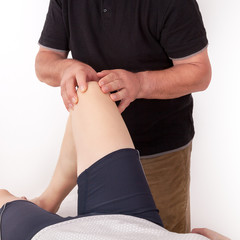 Woman can treat knee by the physiotherapist