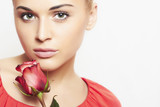 girl and flower. beautiful woman in red dress.make-up.isolate