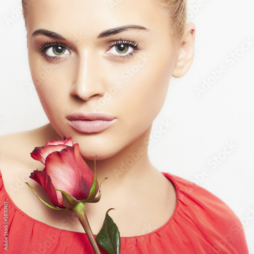 girl and flower. beautiful blond woman in red dress