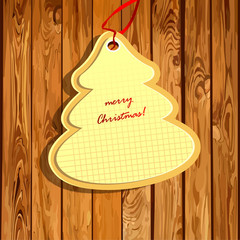 Christmas decorative shape on a wooden background