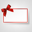 White paper card with gift red satin bow.