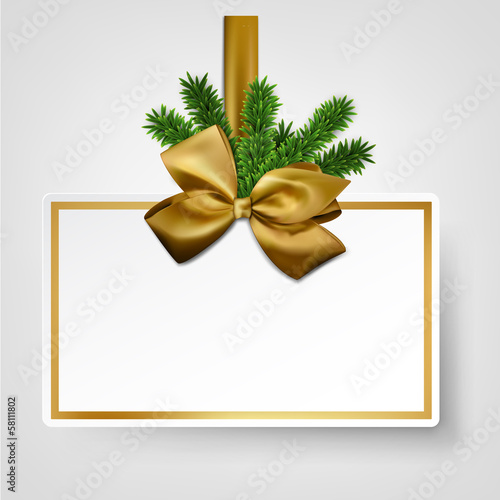 White paper gift card with golden satin bows.