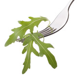 Fresh rucola  salad on fork isolated on white background cutout.