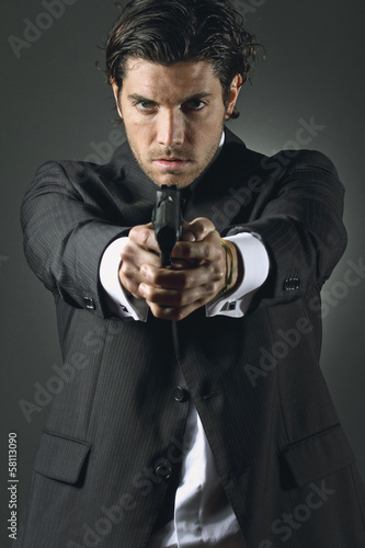 Handsome man with a gun