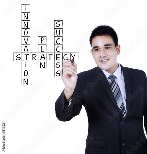 Businessman writing on transparent whiteboard